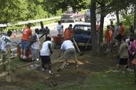 Volunteers working together on lawn work